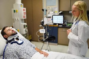 physician with critical care patient